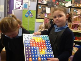 Using Numicon shapes to cover baseboard.b 2